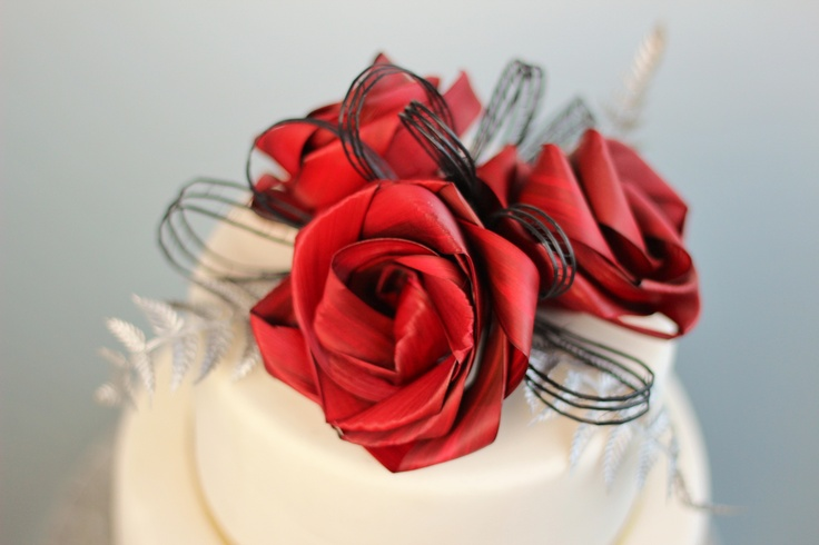 Three flower cake topper with low black loops and silver fern.  www.flaxation.co.nz