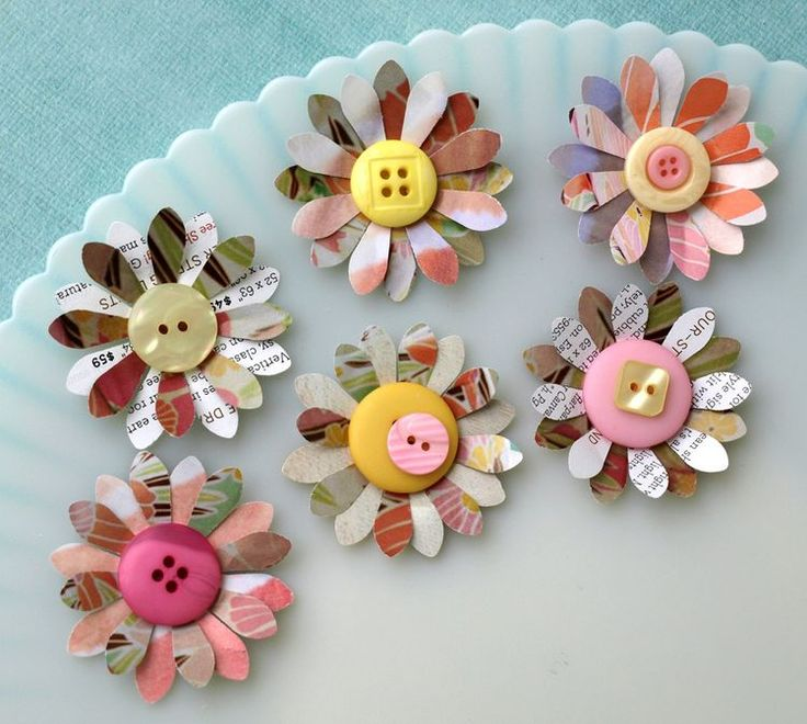 Recycled paper and button flowers. Add these to the tops of little gifts.