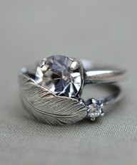Feather and diamond ring.