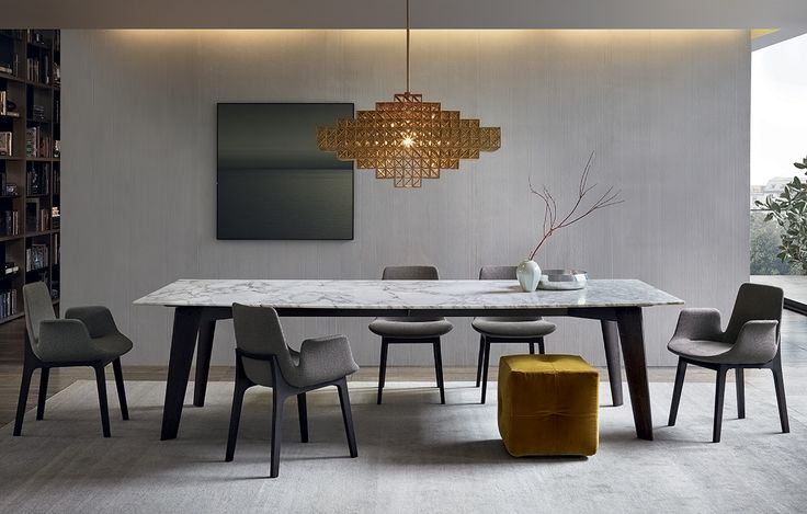 Howard table with structure in spessart oak and mat calacatta oro marble top. Ventura chairs with or without armrest, structure in spessart oak and body covered in 02 tortora Merida fabric. Onda pouf covered in 1403 ocra Persia removable velvet.