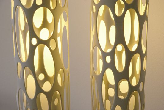 """super cool """"Bone"""" lamps  layering 2 sizes of pvc pipe with light fixture inside"""