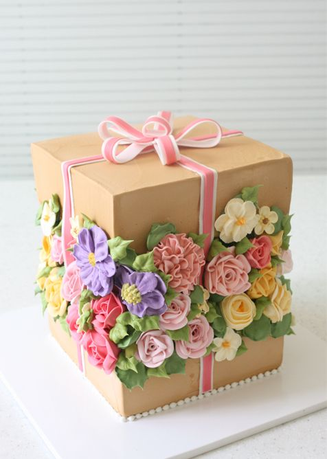 Buttercream florals in a gift box cake