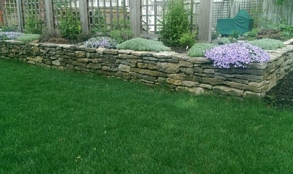 We have 8 sections on How to build a dry-stacked stone wall.There is nothing like the look of a well built dry stacked fieldstone wall.
