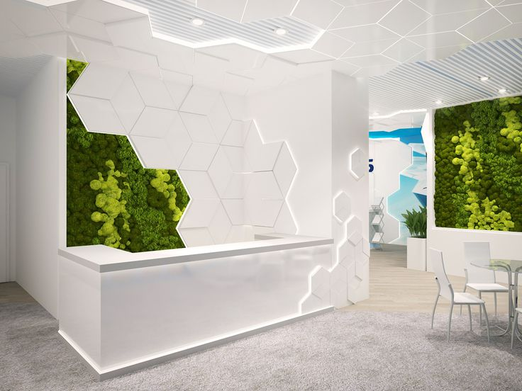 office receptions. white office interior front desk with hexagonal wall tiles ligitng ans moss mural receptions