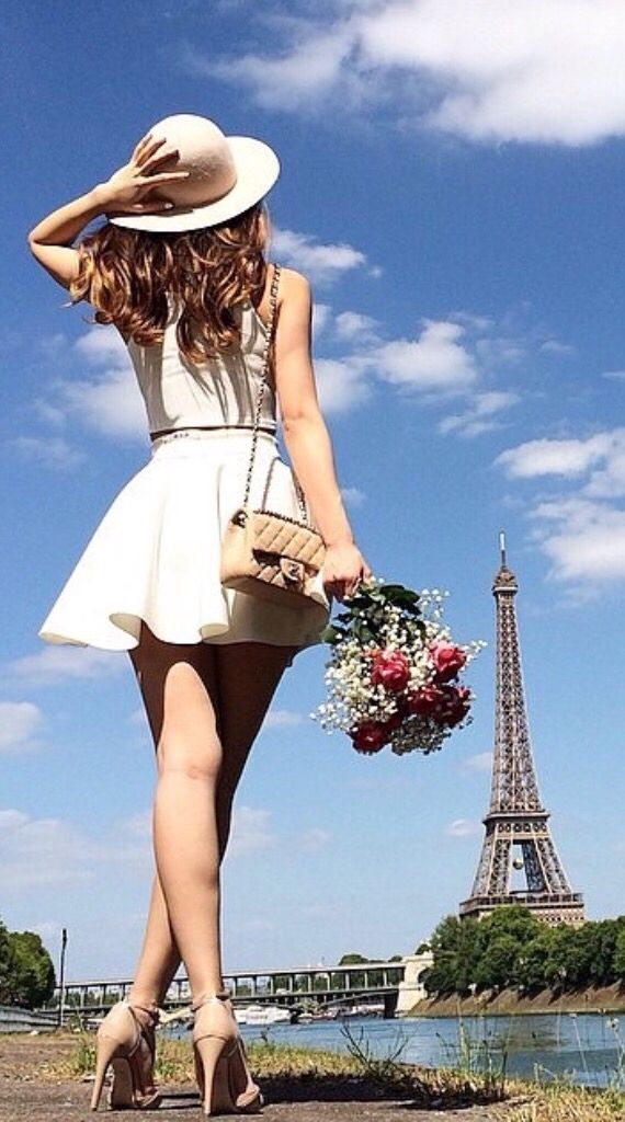 cute pose; from behind, looking up at the Eiffel tower. I'd have her closer (and mindful of clothing).