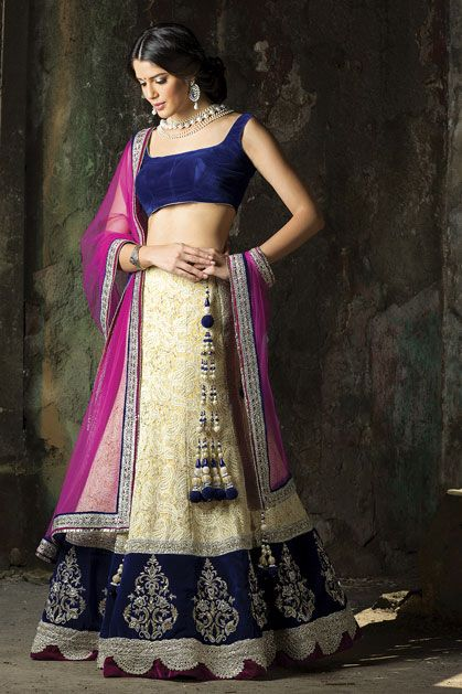 Gold lehenga with navy velvet blouse and contrast dupatta.