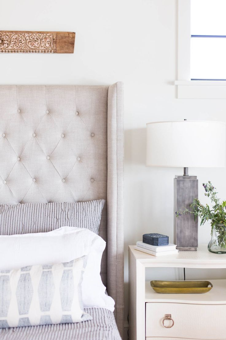 Tufted linen headboard, blue and white linens, neautral bedroom - Ashley Winn Design