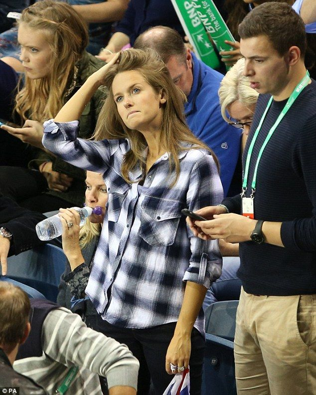 Feeling bored? Kim Murray appeared a bit distracted as she watched husband Andy play in the Davis Cup doubles Semi-Finals with his brother Jamie in Glasgow on Saturday