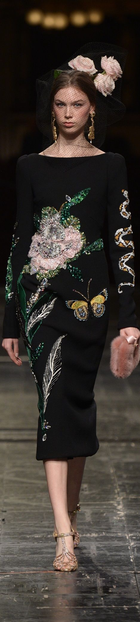Using dark fabric would allow me to highlight the embroidery well. I could sew butterflies around the peacock feathers.