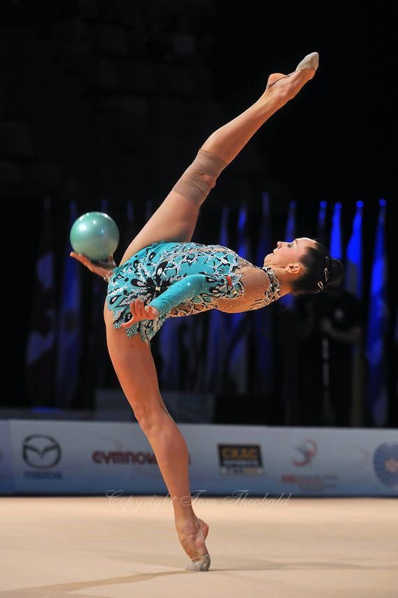 Liubov Charkashyna of Belarus performs balance with hoop during event finals at World Cup Montreal on January 30, 2011.  (Photo by Tom Theobald).