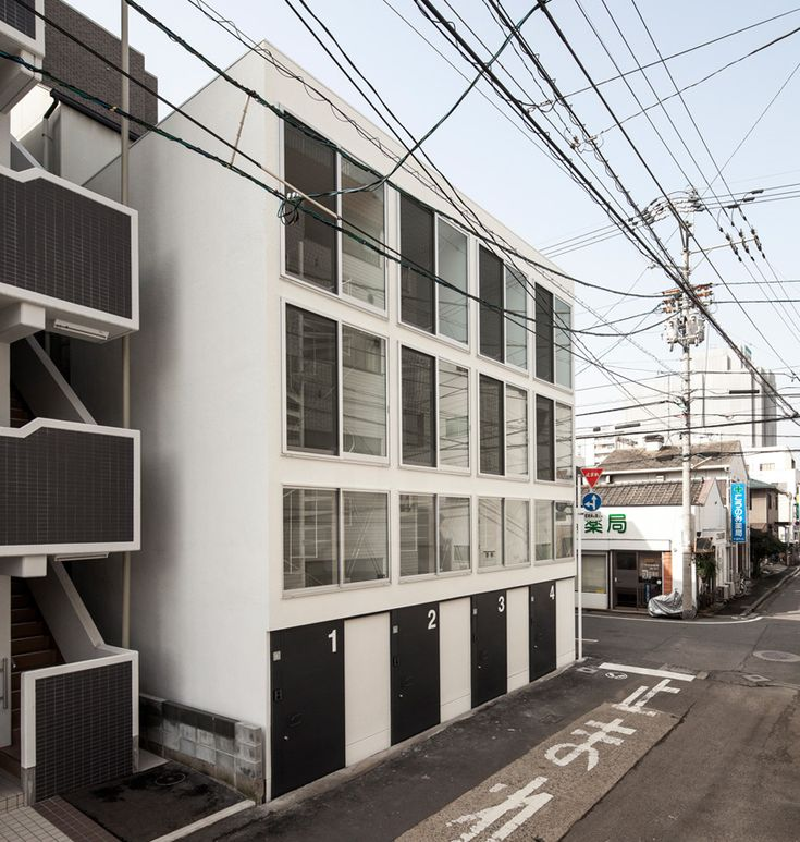 be fun design combines four narrow dwellings for spiral house in japan - designboom   architecture