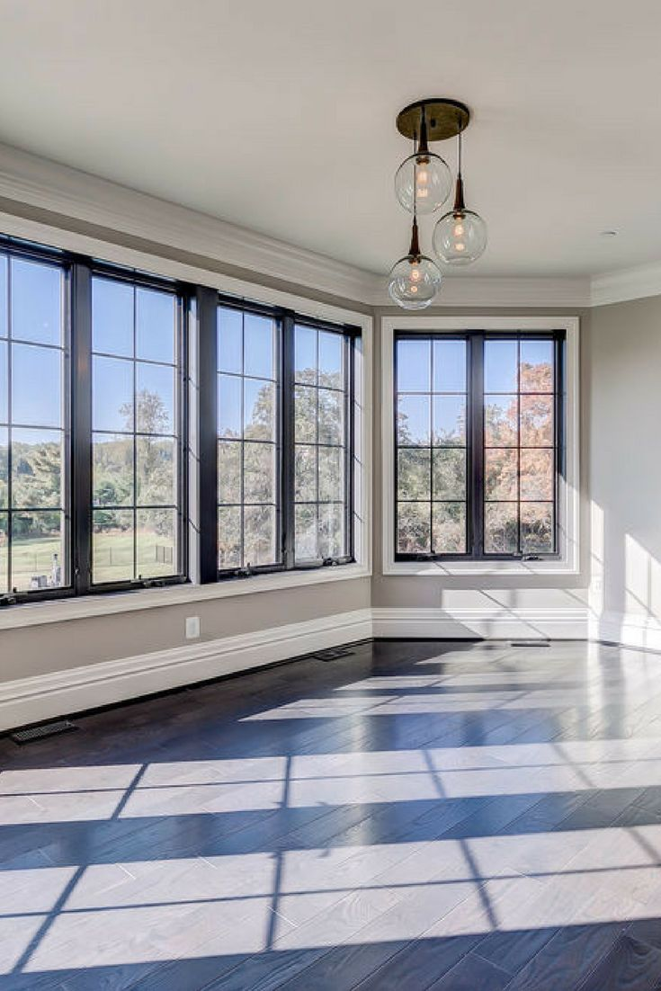 Black interior patio doors are a great accent to a neutral room with white molding.