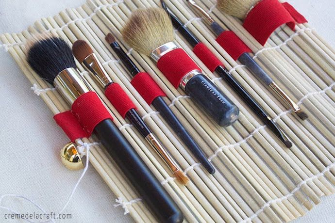 Creative makeup storage idea: Roll brushes in a sushi mat with a strip of elastic sewn in.