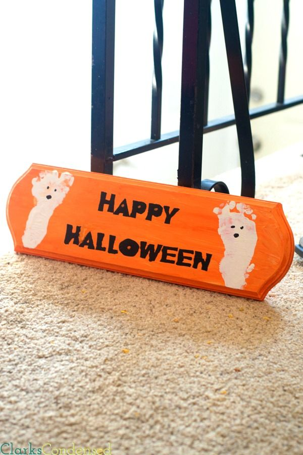 An easy Happy Halloween sign with ghost foot prints - stencil made using Silhouette