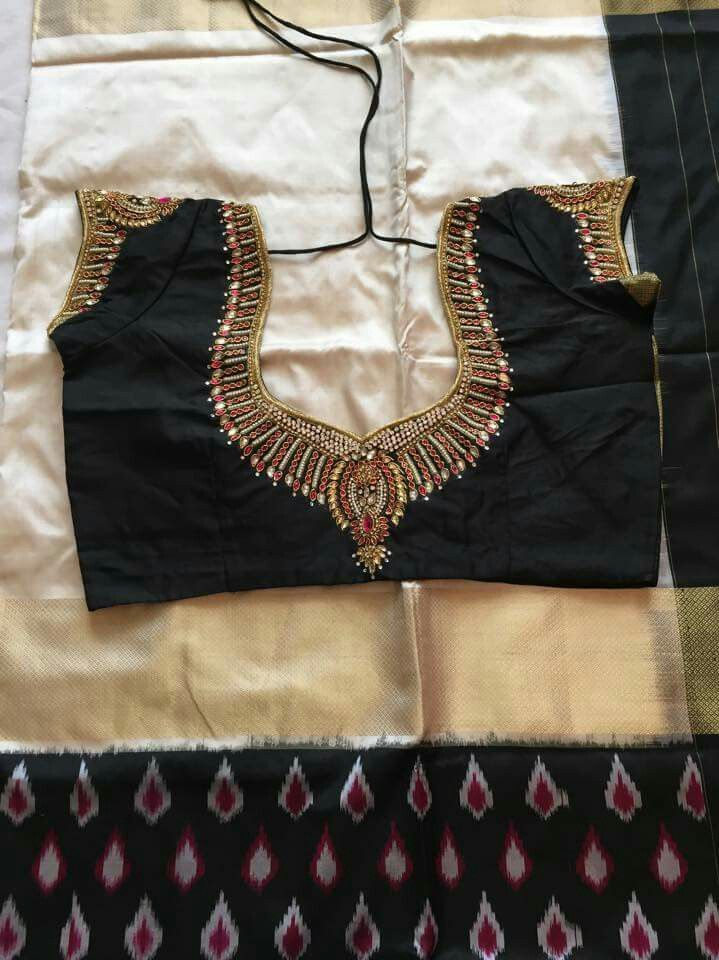 Black and gold saree and blouse. Love the embroidery :)