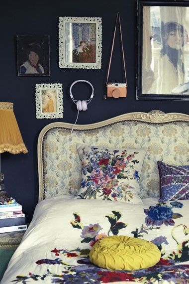 dark walls and cheery light floral, vintage, bohemian bedroom:: wall color yellow