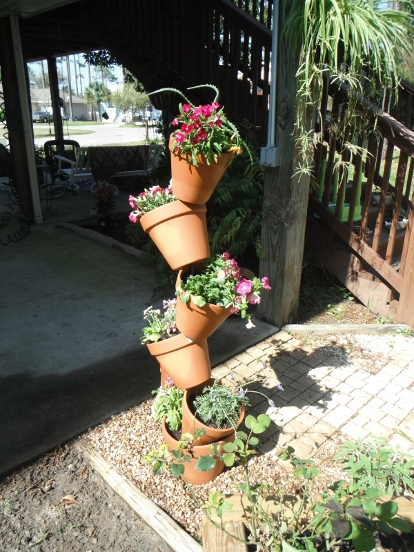 To make a tipsy flower pot stand, get at least 76 inches