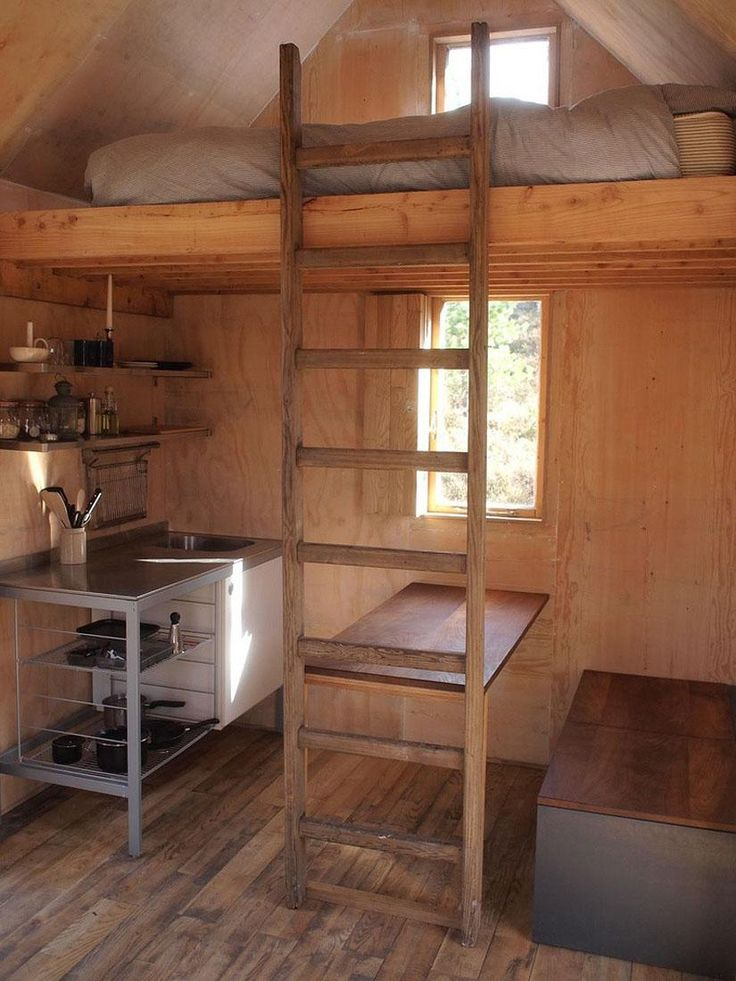 tiny minimalist cabin. love to see home stripped down to the essentials. what more do you need?