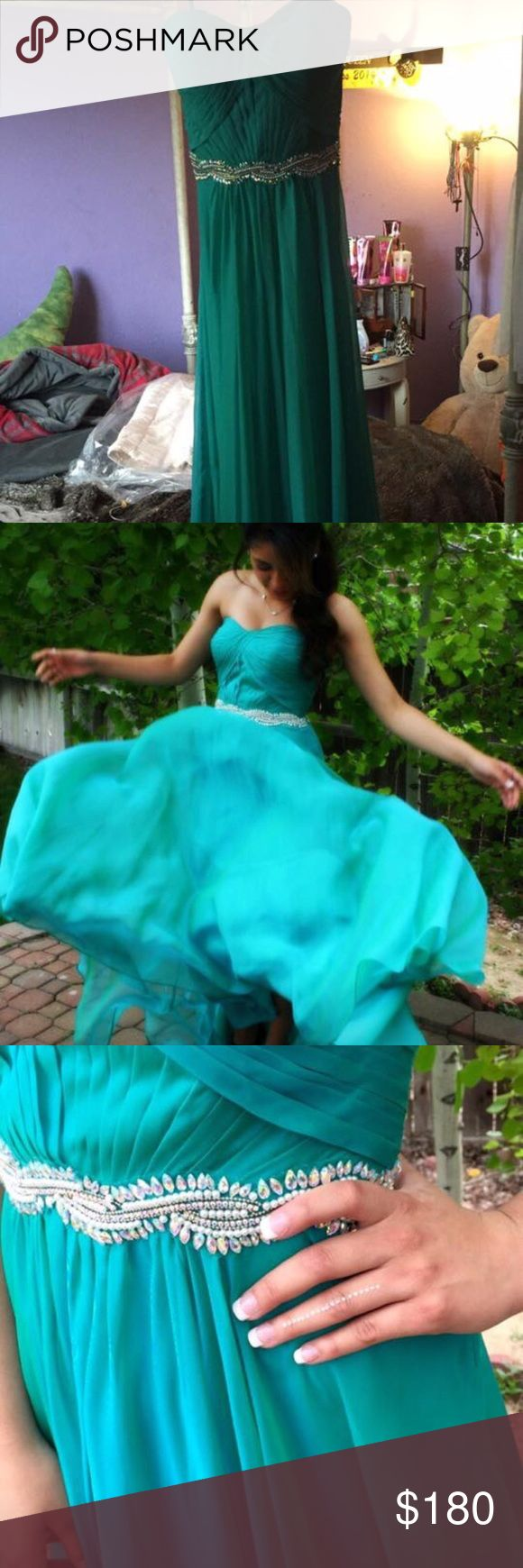 Turquoise Prom Dress Only worn once in 2015 Purchased at the Bridal Collection so no one else has it Sweet heart neckline  Strapless  Doesn't need a bra  Beading goes all the way around Long enough to wear heels Victoria's Bridal Collection Dresses Prom