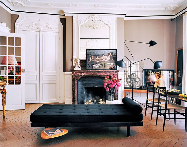 Giambattista Valli's Paris home with futon-style couch and modern light fixtures.