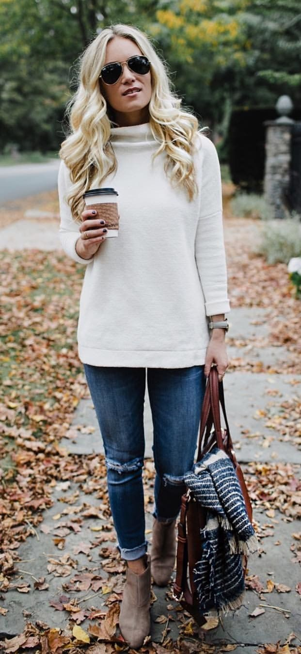 #fall #outfits women's white turtle-neck sweater with distressed blue denim jeans and brown heeled boots outfit