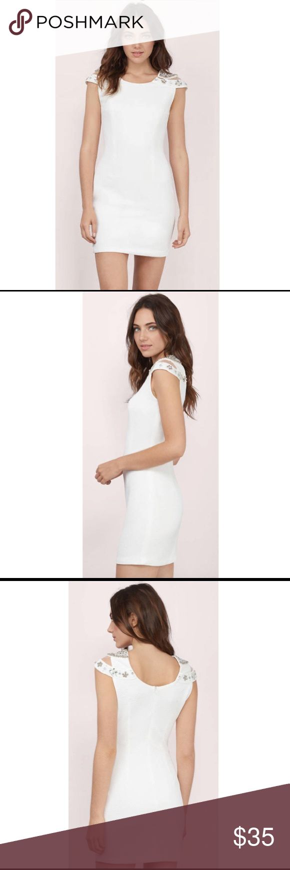 Pure Jewel Ivory Bodycon Dress White dress perfect for any special occasion featuring cap sleeves with jeweled embellishments.  Never been worn! Dresses