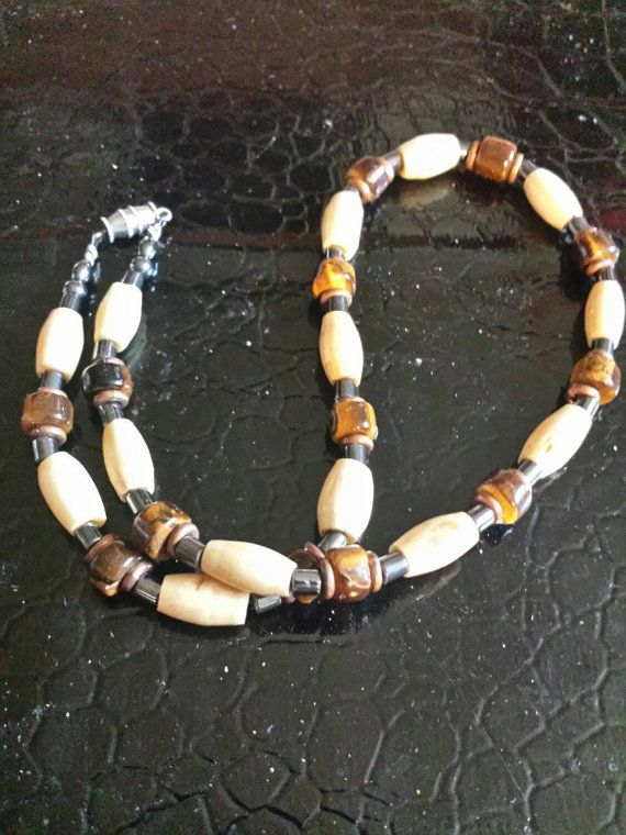 Check out this item in my Etsy shop https://www.etsy.com/listing/232623792/vintage-bead-necklace-tigers-eye-beads