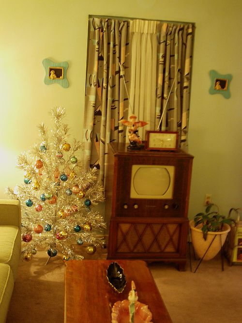 My in-laws had one like this with a light that changed colors shining up into the tree.  Oh, and notice the TV?  We had one that was a hand-me-down from my in-laws when I was first married in 1971 that looked a lot like this.