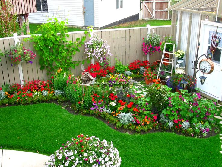Backyard flower garden outdoors pinterest gardens for Garden designs for small backyards