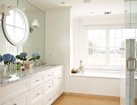 Mirror reflects the windows making them appear even bigger: Hampton Summer, Wall Mirror, Bathroom Mirror, Mirror Wall, White Bathroom, Bathroom Ideas, Round Windows, Master Bathroom
