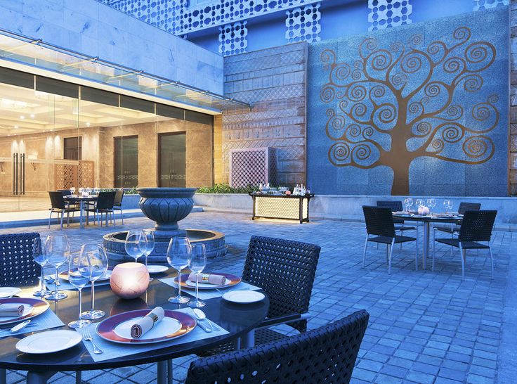 The tree of life wall frieze sets the mood at this open, high ceilinged dining space at #TajCoromandel#Chennai