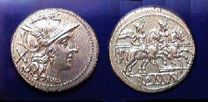 """Denarius - (plural: denarii) In the Roman currency system, the denarius was a small silver coin first minted in 211 BC. It was the most common coin produced for circulation until it was replace by a double denarius known as the antoninianus issued by Caracalla. The word denarius is derived from the Latin dēnī """"containing ten"""", as its value was 10 asses that is denoted by the Roman numeral """"X"""" behind the bust of Roma signifying its value."""