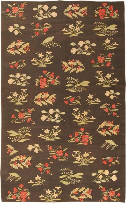 Romania, Circa 1900 - Sprays of naturalistic plants and flowers are arrayed in columns on this lovely antique Bessarabian Kilim. While influenced by the realistic floral detail of French Aubusson flatwoven carpets, the effect here is quite distinctive by virtue of the arrangement in rows or columns. The richness of the colors comes through especially well against the dramatic black ground.    Size: 4 ft 10 in x 7 ft 9 in (1.47 m x 2.36 m)    Price:        $7,200.00  877-784-3463