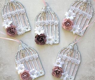 Christmas tree ornaments ... luv these shabby chic bird cages with flowers ... Tim Holtz die cuts ...