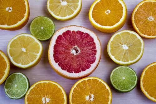 Citrus fruits. Over wood table background by komarinansk  IFTTT 500px