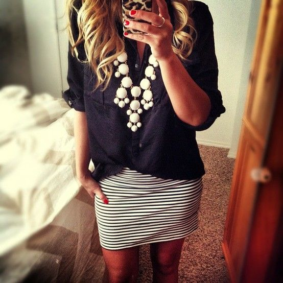 striped skirt, navy blouse, white bib necklace-- effortless style