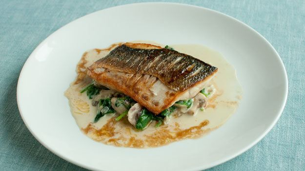 Pan Fried Fillet Of Sea Bass On Spinach With Sautéed Garlic Butter Sauce