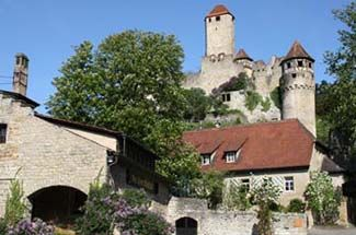 Burg Hornberg, Neckarizimmern, Germany  - dates back to 1184  - offers 23 rooms and 1 suite  - there is a museum and a vineyard on the grounds