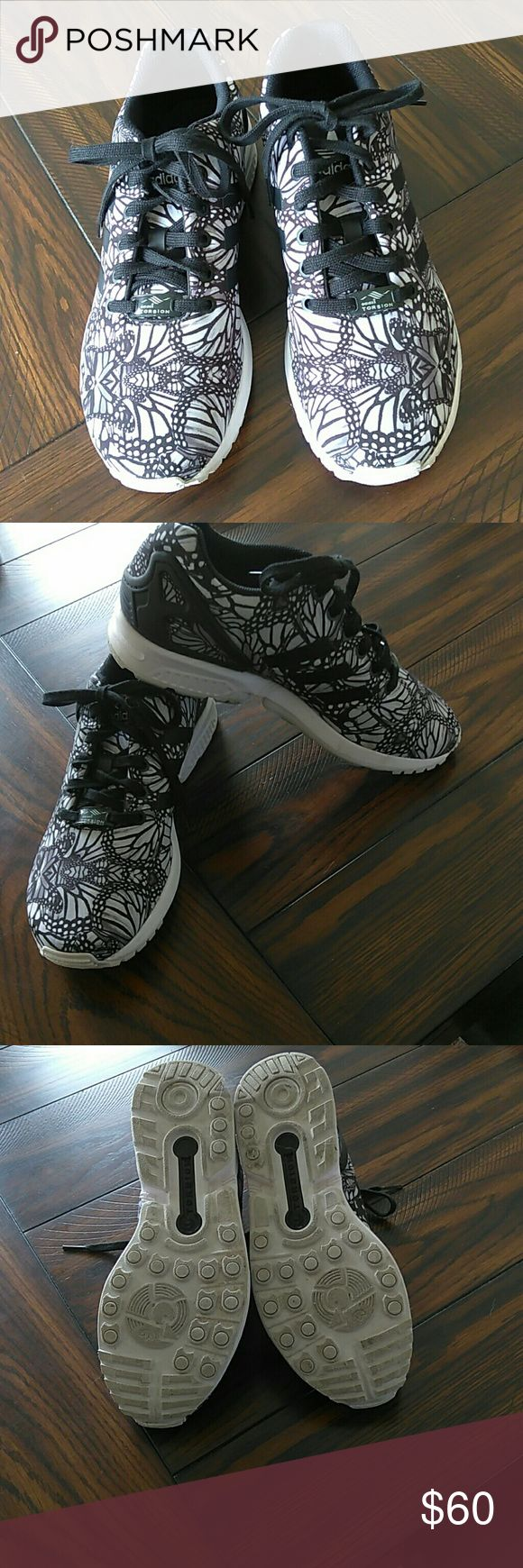 Adidas Torsion ZX Flux Butterfly Black and white with a cute butterfly print. Excellent condition! Signature three black stripes on sides! Super cute and fashionable! Don't pass these up! Adidas Shoes Athletic Shoes