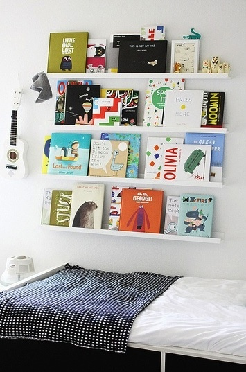 Long book ledges in dinning room to display cute baking and cookbooks. Grid gallery above