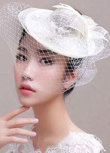 Ivory Royal Wedding Hat with Birdcage Veil