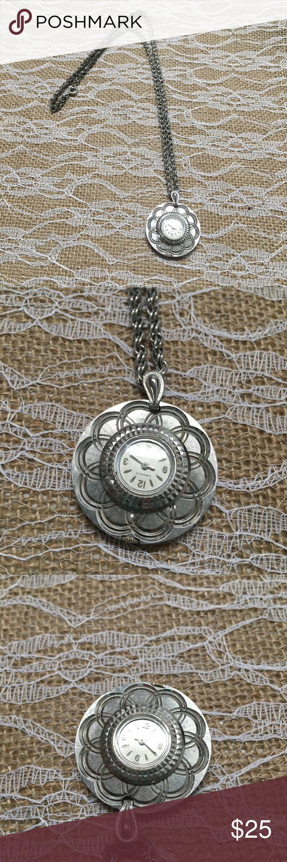 Beautiful silver tone clock necklace This is a good condition Vintage Caravelle piece it has wind up clock that is attached to necklace it is upside down so you can tell what time it is when you look at it it works still winds up Jewelry Necklaces