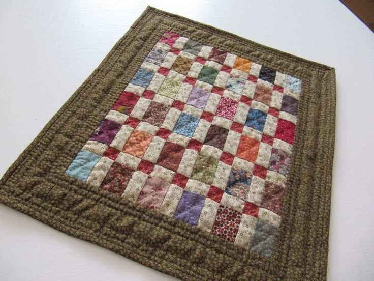 Little quilt/ like how the red and white crosses tied all the other colours together.