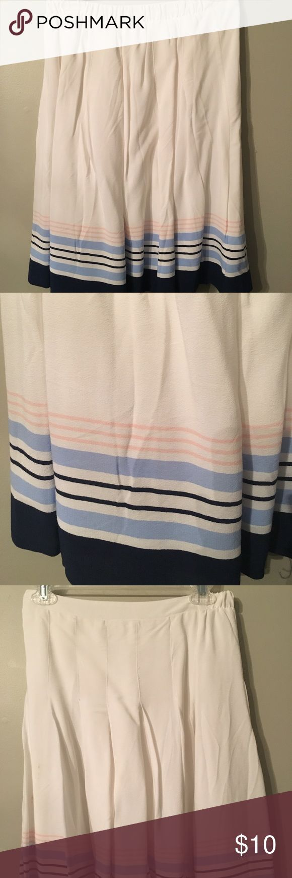 Old Navy Striped Skirt This very flattering skirt is in almost perfect condition. There is a small stain that is pictured above. Fits like a small Old Navy Skirts