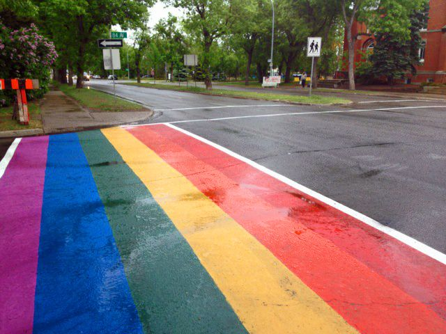 Temporary rainbow crosswalks on Whyte Avenue in honour of Pride Week.  Our Transportation Department teamed up with CITYlab, the Old Strathcona - Whyte Avenue and community members to make these colourful installations happen. #whyteave #Edmonton #rainbow #sidewalk