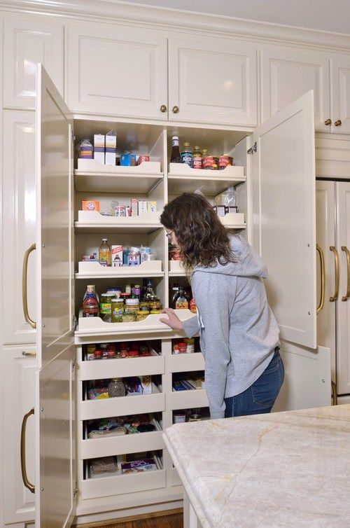 The pantry: Previously located in a small closet, it was redesigned as a  custom wall of cabinetry with better access and more storage. Whil...