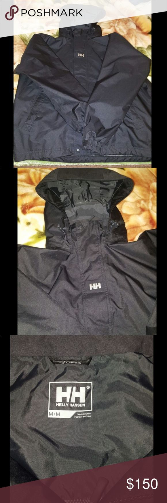 Mens Helly Hansen Coat NWOT..NEVER WORE..DONT HAVE TAGS SO I COULDN'T RETURN IN STORE..BLACK. VERY WARM. WATER PROOF. HIDDEN POCKET INSIDE. SIZE MEDIUM. HOOD CAN BE FOLDED DOWN AND HIDDEN . OPEN TO OFFERS Helly Hansen Jackets & Coats