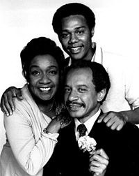Sherman Hemsley, Isabel Sanford and Mike Evans as the Jeffersons; George, Louise and Lionel (1974).  The Jefferson's focuses on George and Louise Jefferson, an affluent Black couple living in New York City. The show was launched as the second spin-off of All in the Family, on which the Jeffersons had been the neighbors of Archie and Edith Bunker.