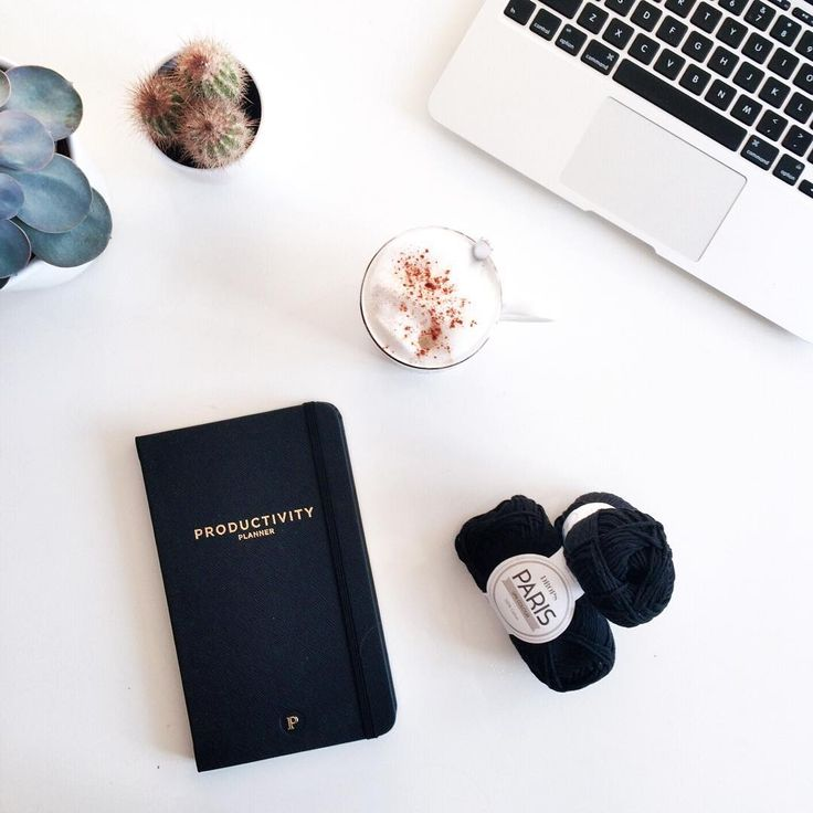 working from home » flatlay with macbook, productivity planner, coffee, cacti, and cotton yarn