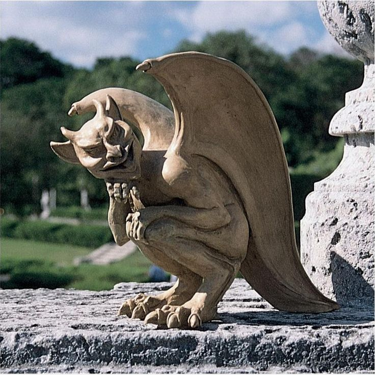 """Even Scotland Yard couldn't unravel the tales told of a mysterious """"hopping creature"""" who repeatedly left gargoyle-like tracks outside Cambridge, England as recently as 1992. Artist Richard Warsin's mischievous gargoyle-with fiery eyes, bony spine, and devilish tongue-crouches ready to pounce on any unsuspecting passersby. This quality designer resin creature is so elusive that he's exclusive to Toscano! 7½""""Wx12½""""Dx10""""H. 3 lbs."""
